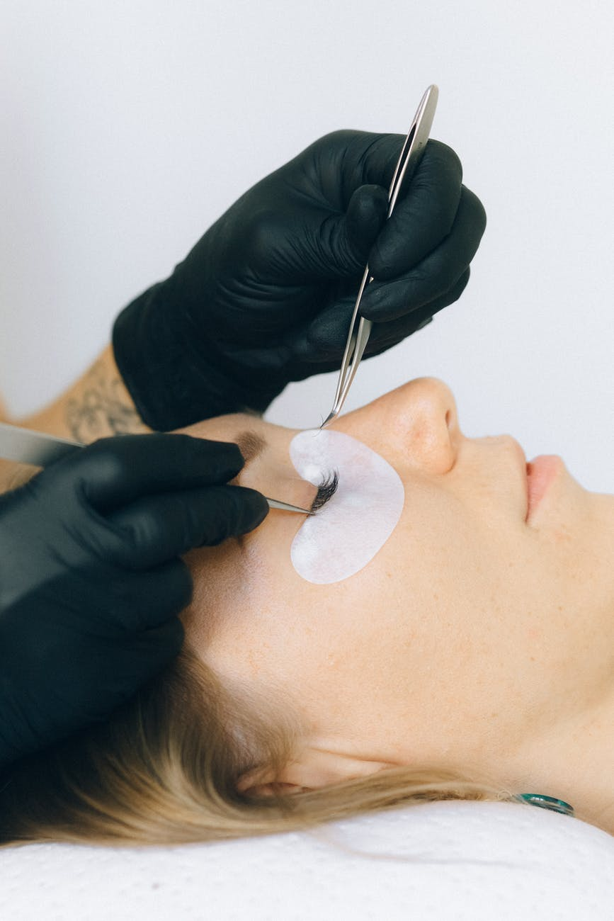 women making eyelash extension